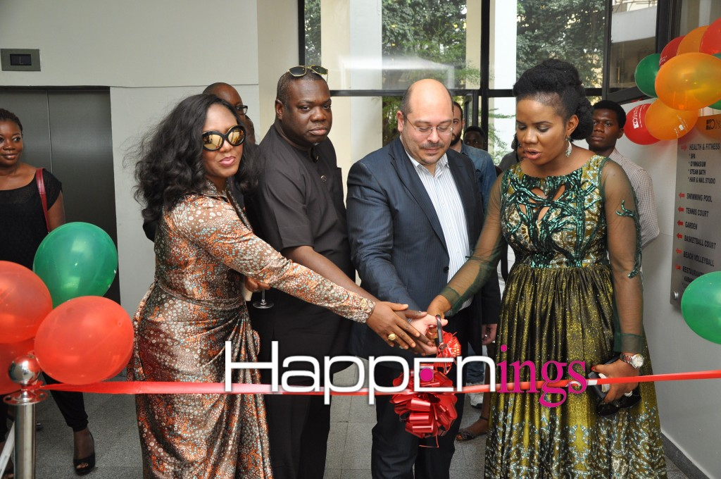 Cutting of tape to declare open the Eko Spa wellness center