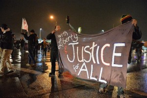 Demonstrators take to the streets in St. Louis, Missouri on November 23, 2014, stepping up pressure on a grand jury to indict a white police officer for shooting dead an unarmed black teenager (AFP) photo:  Michael B. Thomas