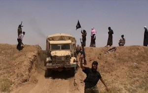 An image made available by the jihadist Twitter account Al-Baraka news on June 11, 2014 allegedly shows Islamic State militants driving across the Syrian-Iraqi border ALBARAKA NEWS (AFP)