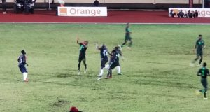 Weah tackled by Ogu, Nigeria vs Liberia