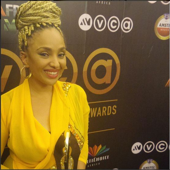 Lola MajaHolding Her AMVCA For Best make up artiste in the movie October 1