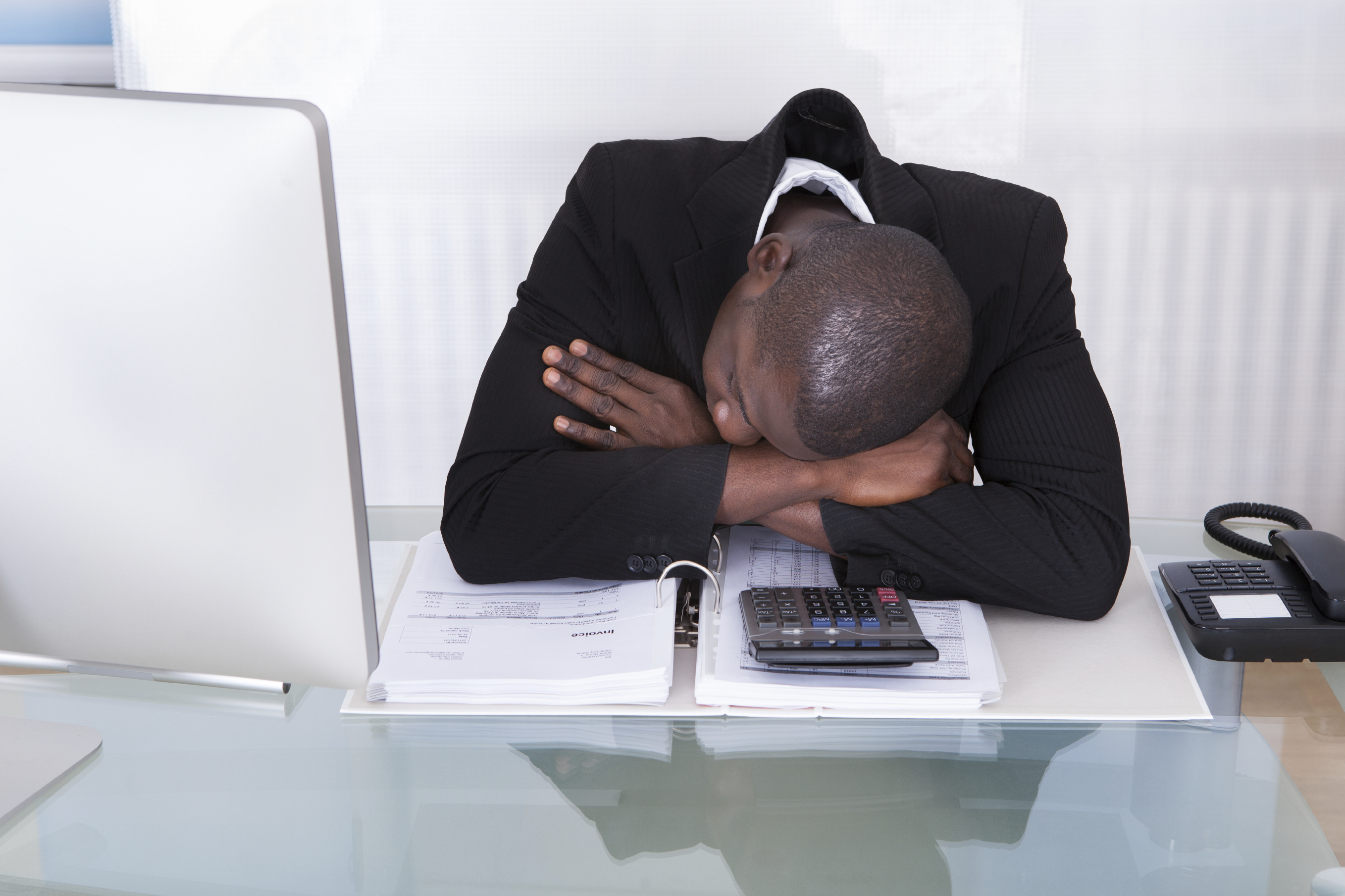 Portrait Of Stressed Businessman Sleeping In Office