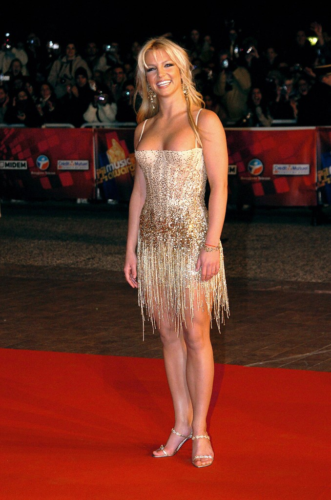 "CANNES, FRANCE:  US rock star Britney Spears arrives 24 January 2004 at Cannes' Palais des Festivals, for France's annual NRJ music awards. The awards are held as the International music industry descends on Cannes, southern France, for the annual MIDEM trade jamboree, the music world's premier trade show. The NRJ pop music station's awards are based on a public vote, with around 50 artists competing for 15 awards. NRJ is a popular commercial FM radio network whose name, when pronounced in French, makes the word ""energy"". AFP PHOTO PASCAL GUYOT   (Photo credit should read PASCAL GUYOT/AFP/Getty Images)"