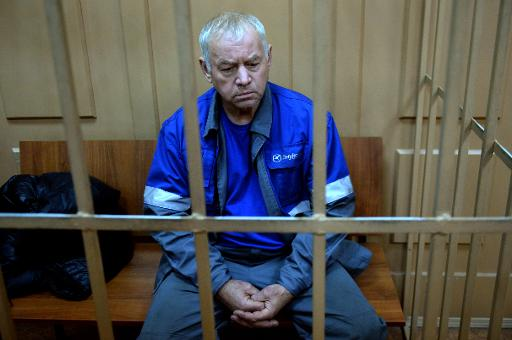Vladimir Martynenko, the driver of a snowplough involved in the crash that killed the head of French oil giant Total, sits in the defendant's cage during his hearing at a Moscow court on October 23, 2014