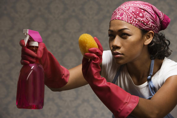 Mixed race housewife standing with cleaning supplies Image downloaded by Bryan Ogilvie at 20:06 on the 28/02/11