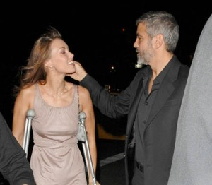 George Clooney caresses his girlfriend Sarah Larson as they attend a private event in New York City. Ref: SPL4335 300907  Picture by: Ronald Asadorian / Splash News Splash News and Pictures Los Angeles: 310-821-2666 New York: 212-619-2666 London: 870-934-2666 photodesk@splashnews.com