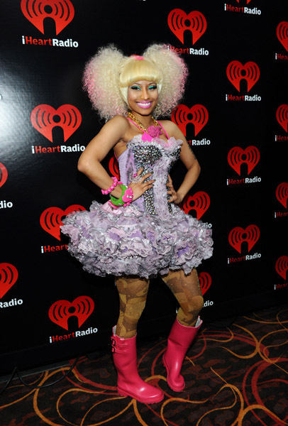 poses backstage at the iHeartRadio Music Festival held at the MGM Grand Garden Arena on September 24, 2011 in Las Vegas, Nevada.