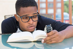 not-enough-time-closeup-portrait-nerdy-young-man-big-black-glasses-holding-watch-falling-very-tired-reading-isolated-48504216
