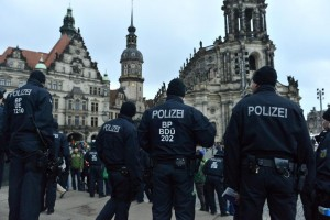 Police keep watch after a rally by German right-wing populist movement PEGIDA (Patriotic Europeans Against the Islamisation of the Occident) in Dresden's historic centre, on January 25, 2015 (AFP) photo:  John MacDougall