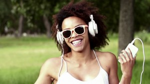 stock-video-39249796-african-american-young-woman-listening-to-music-on-headphones